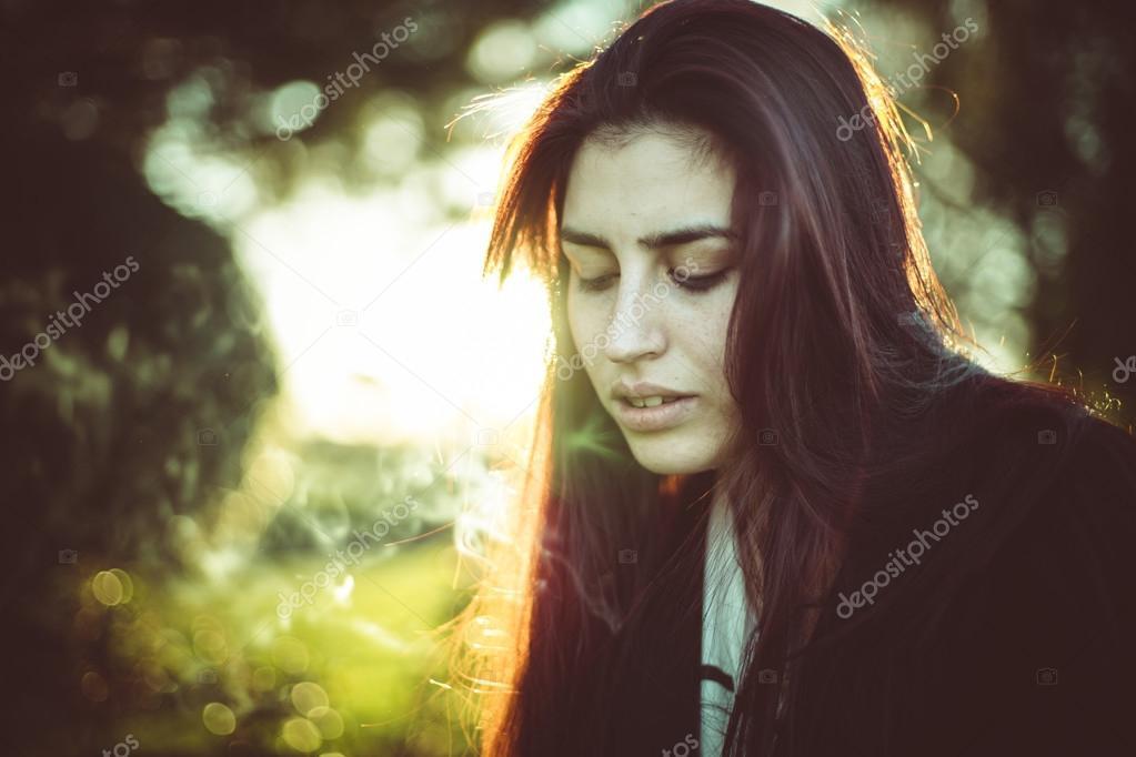 Young, beautiful woman at sunset