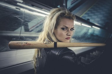 Sexy blonde with a baseball bat