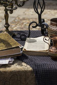 Fotografie Antique books and writing accessories