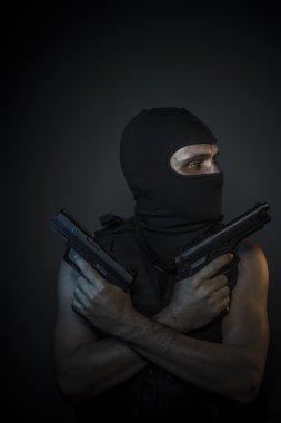 Man  holding  guns