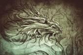 Fotografia Testa di drago medievale. Disegno del tatuaggio sopra priorità bassa grigia. Textures