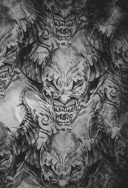 Tattoo pattern with demon designs over antique paper
