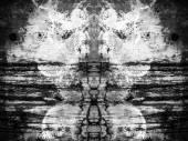 Fotografie geometrische Formen, die auf eine alte Betonmauer gemalt