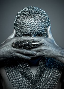 medieval executioner in mesh iron rings on the head
