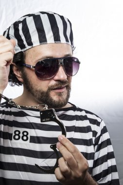 man prisoner in prison garb