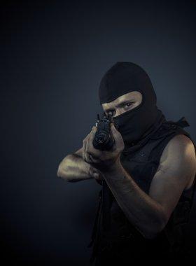 terrorist carrying machine gun