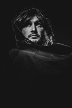 vampire man in large black cloak