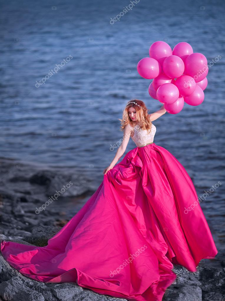 beautiful girl with pink balloons