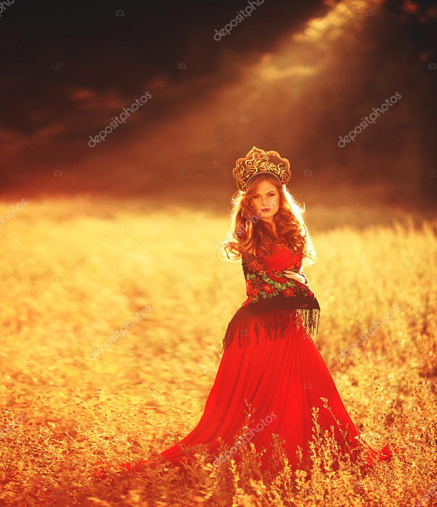 Girl in red dress and russian traditional headdress