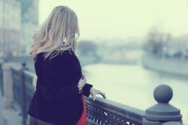 Young beautiful girl walking in city