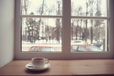 Coffee cup on windowsill
