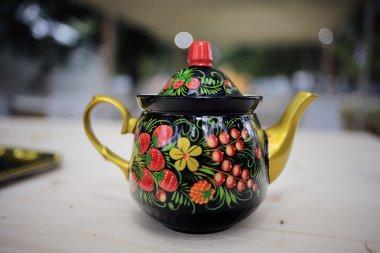 Vintage teapot in khokhloma painting style