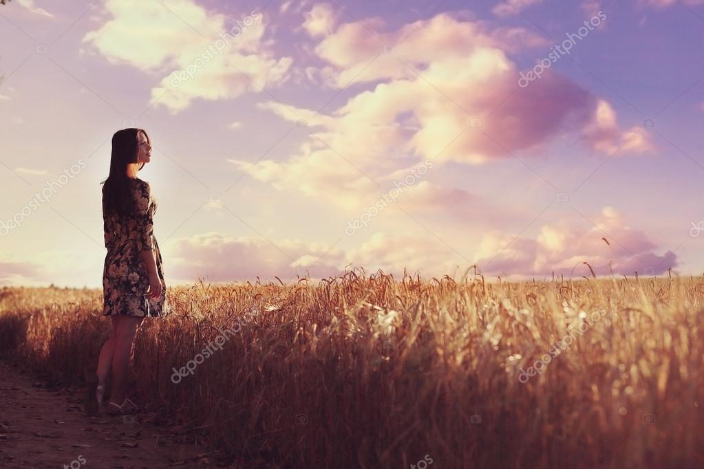 girl in the rustic landscape of wheat