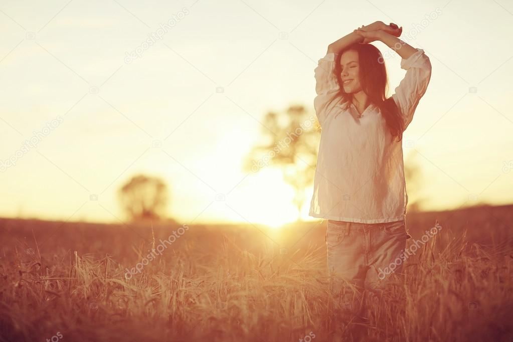 Girl stretches at sunset