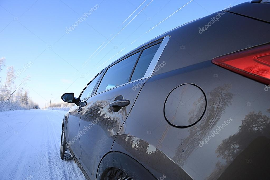 winter road and car window