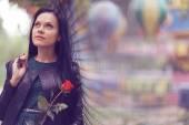 Fotografie Mädchen mit rosa Blume