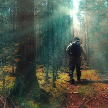 Traveler in autumn mystical forest