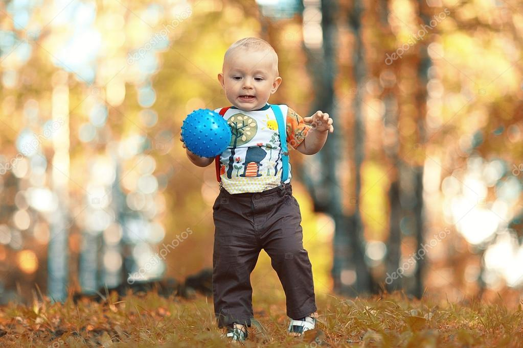 Child playing with ball in park