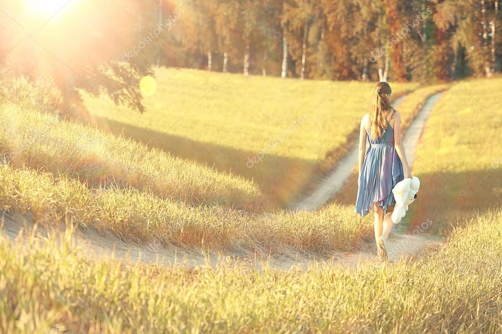 Girl walking in field