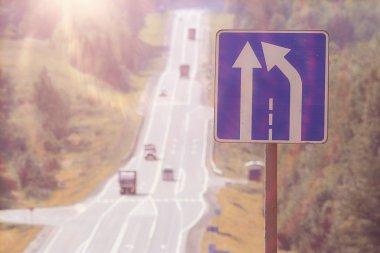 Narrowing road sign