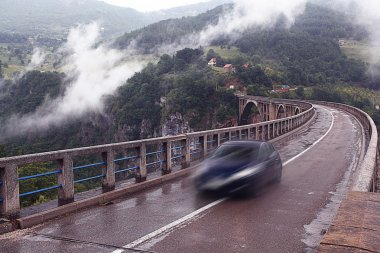 Car on bridge in the mountains