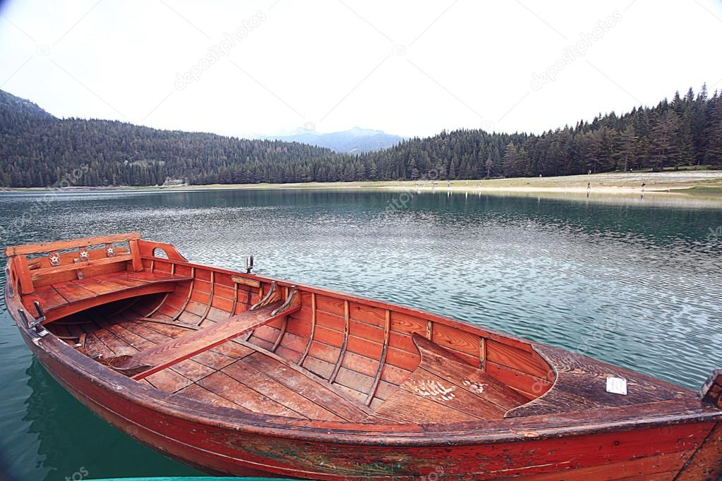 Wooden boat on mooring