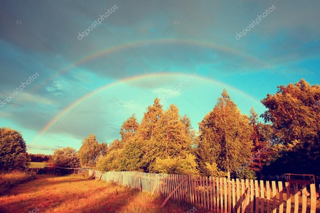 Rainbow over autumn forest