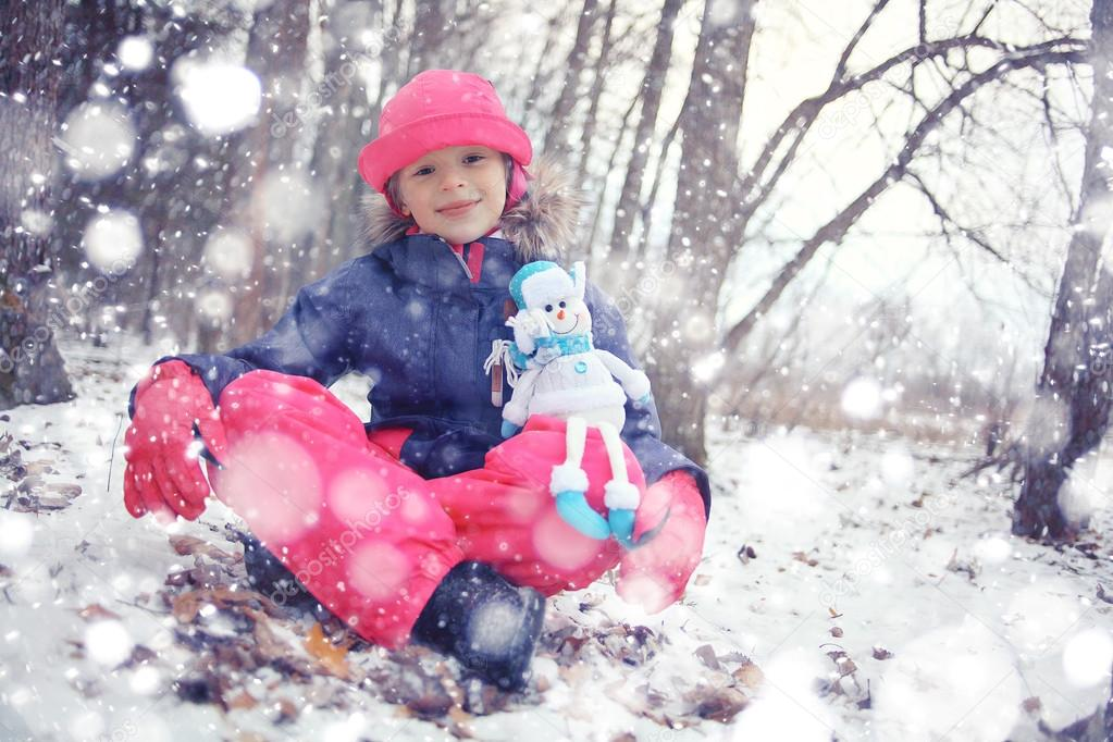 little girl with snowman