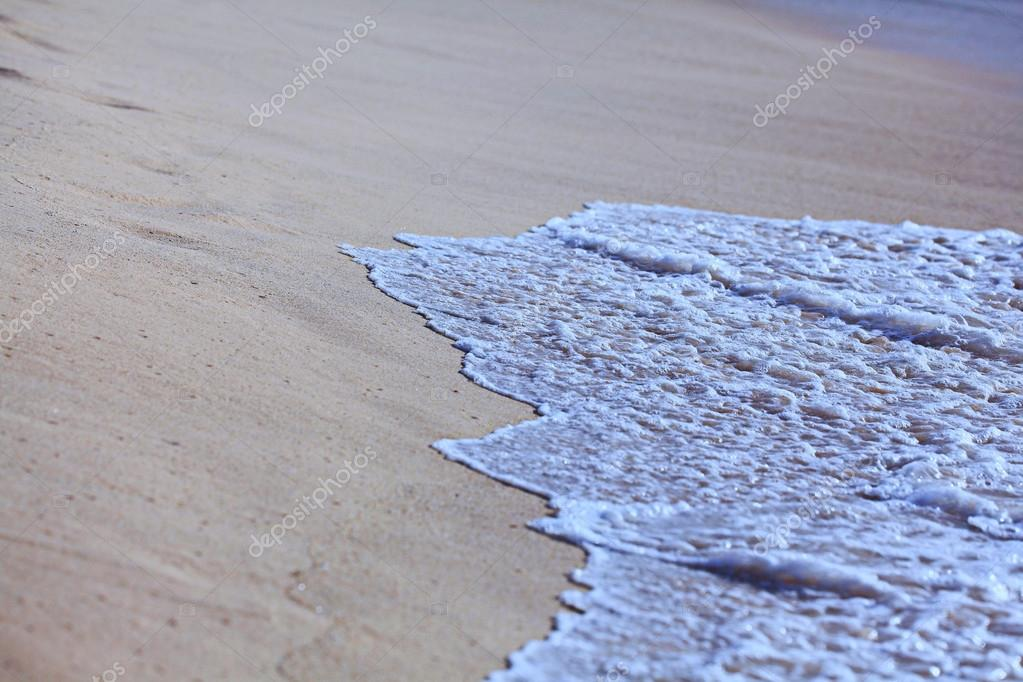 Sea surf wave on beach