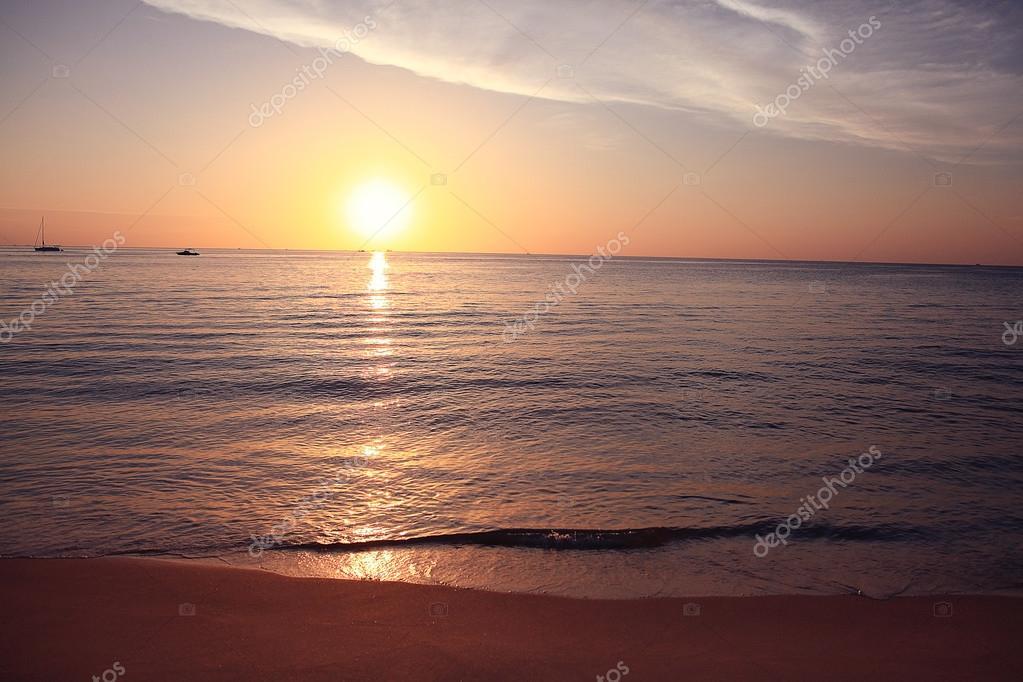 Фотообои Surf at sunset sea beach
