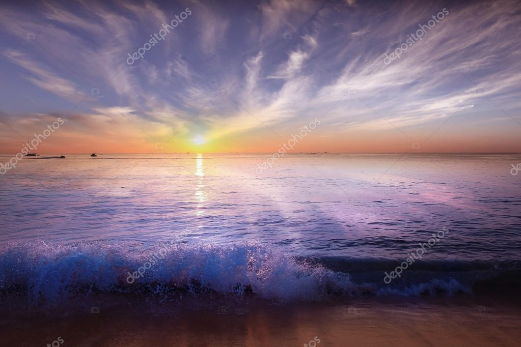 Surf at sunset sea beach