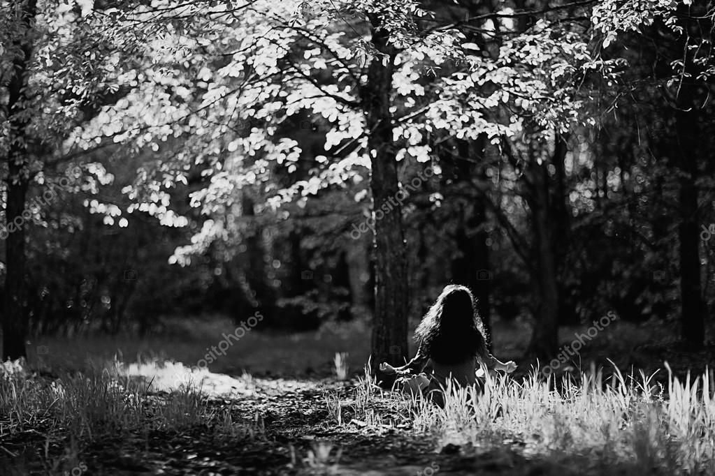 girl meditating near tree