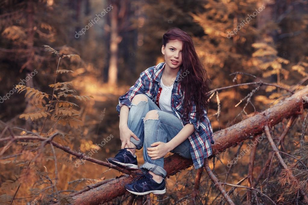 beautiful girl traveling in the woods