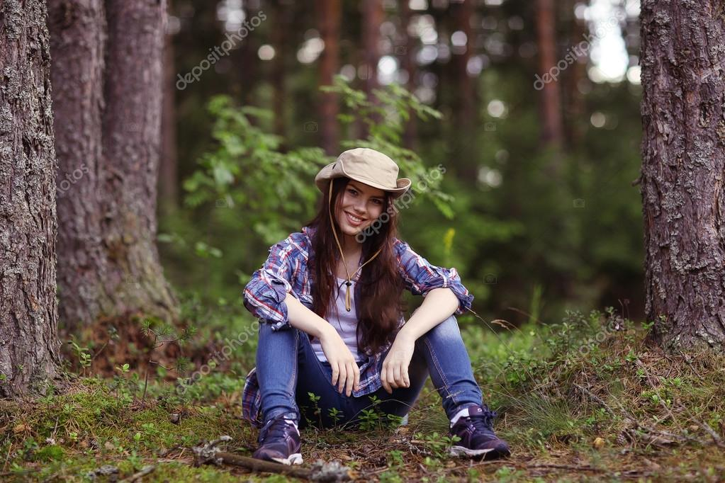 Young girl in the forest ranger