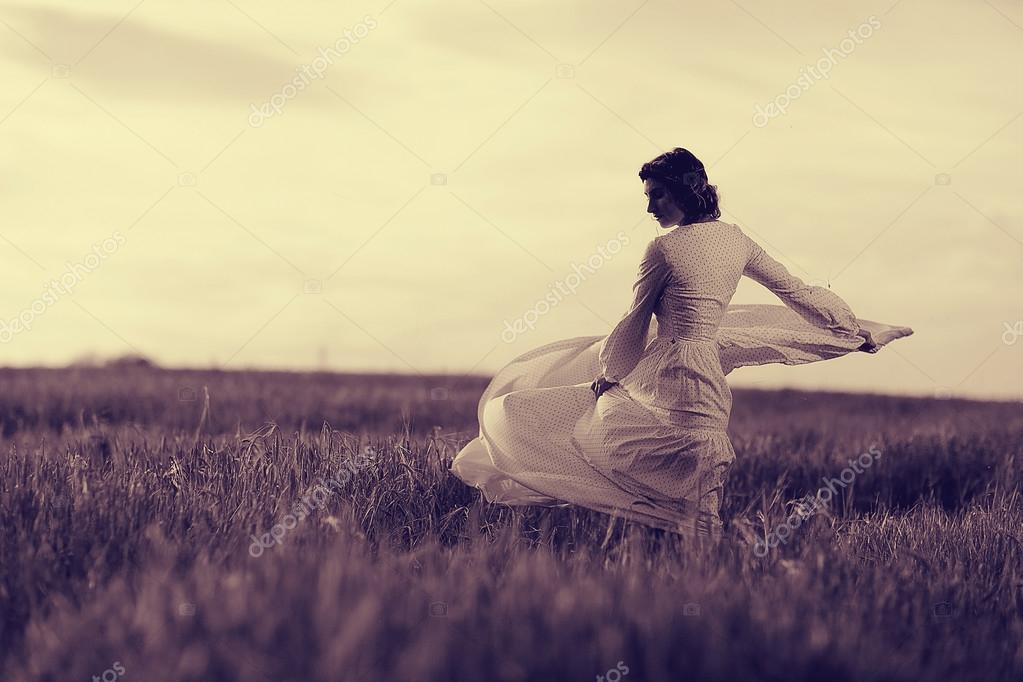 girl in white dress fall outside