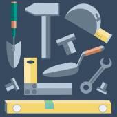 Fotografia Pala di strumenti, livello, spatola, chiave, martello, nastro, misura