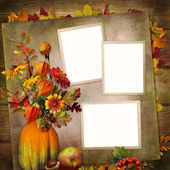 Background with frames, a bouquet of autumn leaves and berries in a vase from pumpkin