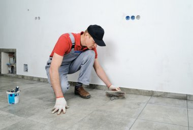 Grouting ceramic tiles.
