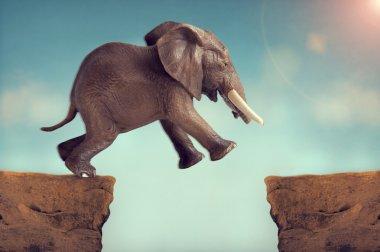 Leap of faith concept elephant jumping across a crevasse stock vector