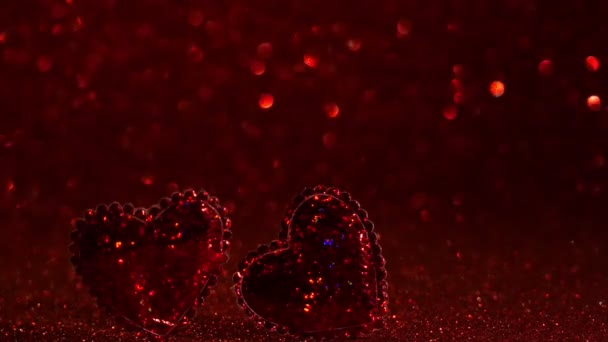 Valentines Day. Red heart on a red background. Valentines Day. Celebrate. Red bokeh of sparkling lights.  Two red hearts. Banner. Heart. 4K