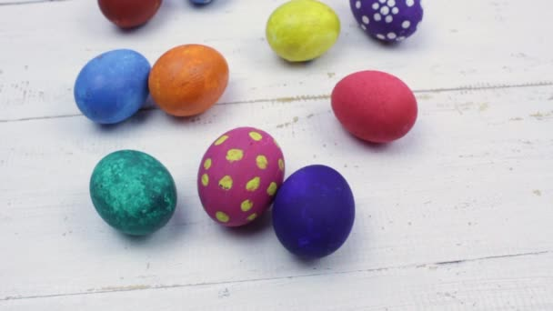 Easter. Multicolored Easter eggs on a white wooden table background.
