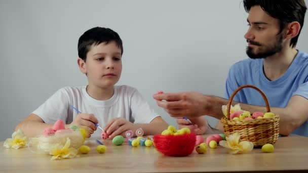 Happy easter. Cute boy is painting Easter eggs. Happy little boy getting ready f