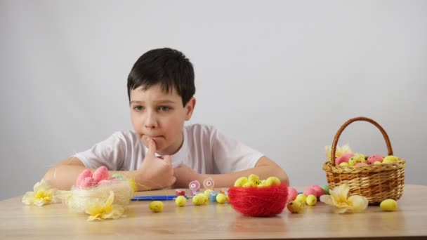 One boy paints eggs. Preparing for Easter. 4K