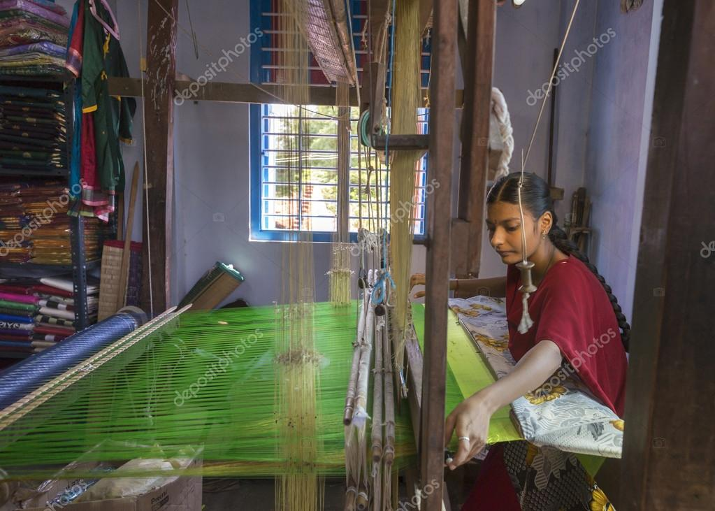Female weaving silk saris on a hand loom.
