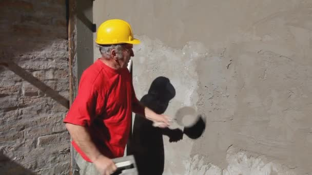 Construction site, worker making facade