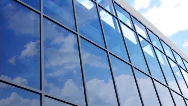 Skleněná fasáda s odrazem mraky