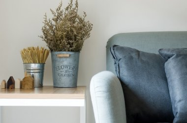 Modern sofa with dry flower in pot
