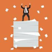 Businessman celebrating on a lot of documents