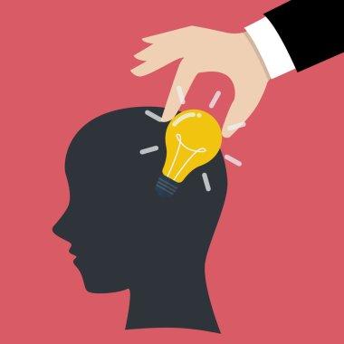 Hand stealing idea light bulb from head