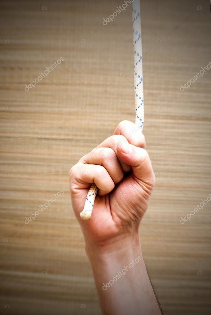 Hand, die stark an ein Seil greifen — Stockfoto © januaryxii #68612655
